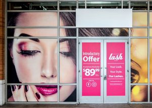 outdoor storefront window vinyl graphics custom 300x214 Temporary Signs