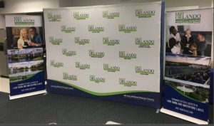 indoor banner tradeshow display vinyl mural backdrop 300x177 Printed Backdrops